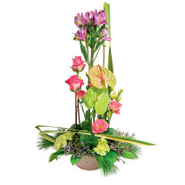 High funeral arrangement of pink, green and purple flowers with rose and anthurium